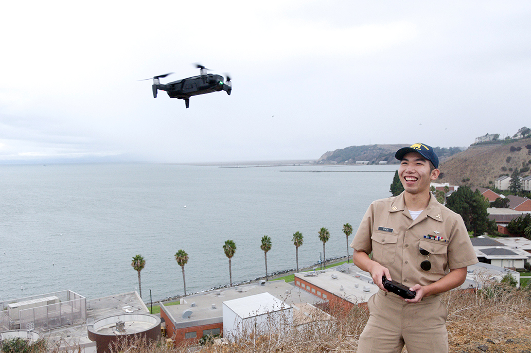 Oliver Chen with drone on campus