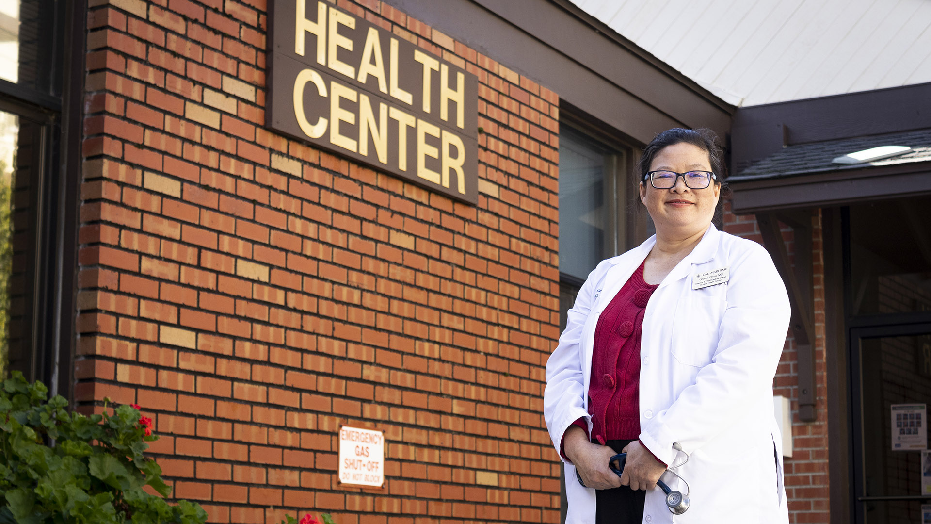 Dr. Grace Chou in front of Student Health Center building